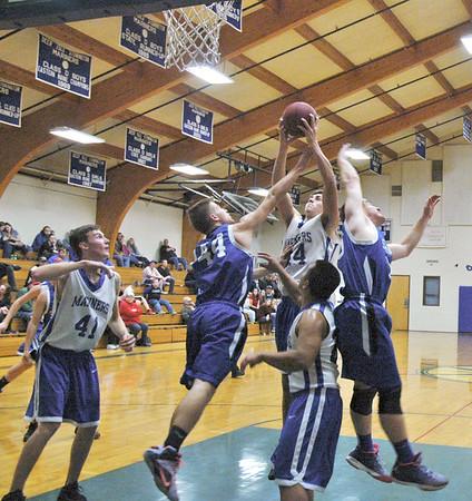 Sports; DIS; boys; Searsport; mason; rebound; 121715 Mason Oliver grabs a rebound over Searsport. Photo by Jack Scott