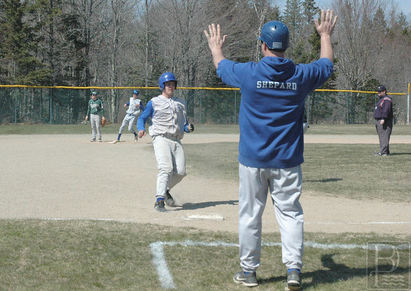 sports; DIS; baseball; scrimmage; ShepardHoldUp; 042116; Deer IsleStonington High School; Mariners; dishs; game; high school; school; team Coach Randy Shepard signals his team. Photo by Jack Scott