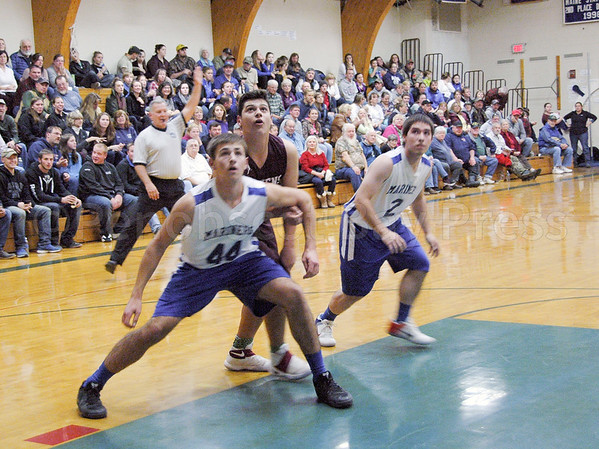 sports; DIS; boys; rebound; 121516; Deer IsleStonington High School; Mariners; dishs; game; high school; school; team From left, Mariner Mason Oliver, left, Eagle Stefan Simmons, and Mariner Silas Bates wait for the rebound. Photo by Jack Scott