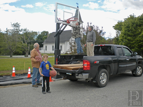 sports; hoop; 061616; DIS; Deer IsleStonington High School; Mariners; dishs; game; high school; school; team Volunteers put the finishing touches on the net for a new public tournament-level basektball hoop in Deer Isle. PHoto by Jack Scott