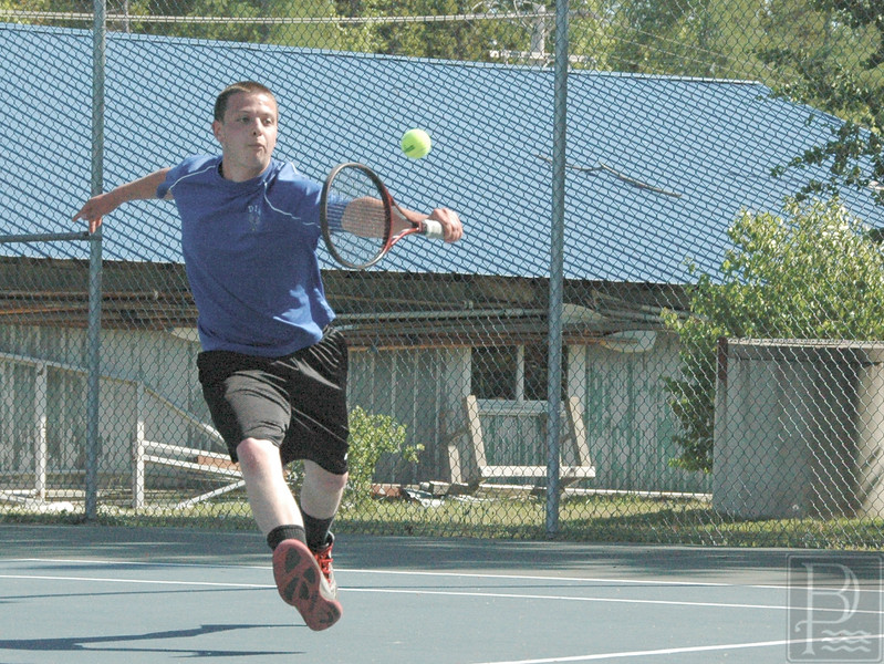 Sports; DIS; Tennis; BrantleyEmrick; 060216 Brantley Emrick backhands a return against Washington Academy. Photo by Jack Scott