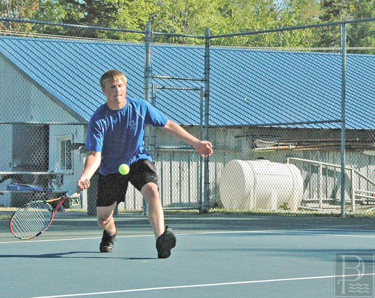 Sports; DIS; Tennis; Cameron; Wendell; 060216 Deer Isle-Stonington senior Cameron Wendell returns against Washington Academy in a 5-0 preliminary playoff match loss. The team is now finished for the season. Photo by Jack Scott