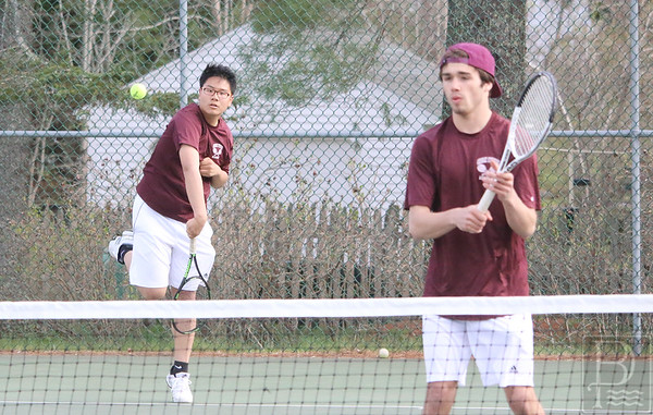 sports; GSA; tennis; Orono; fang; serves; 051216; Eagles; George Stevens Academy; game; high school; school; sport; team Seniors Kent Fang serves with John Larson standing ready.