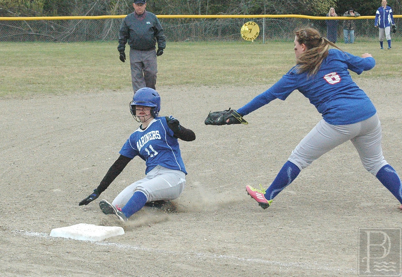 sports; DIS; softball; jonesport; stealing; third; 051916; Deer IsleStonington High School; Mariners; dishs; game; high school; school; team Lily Gray steals third base against Jonesport-Beals. Photo by Jack Scott