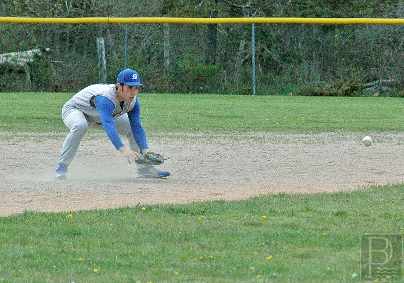 sports; DIS; baseball; jonesport; Silas; Bates; 051916; Deer IsleStonington High School; Mariners; dishs; game; high school; school; team Silas Bates fields a grounder against Jonesport-Beals. Photo by Jack Scott