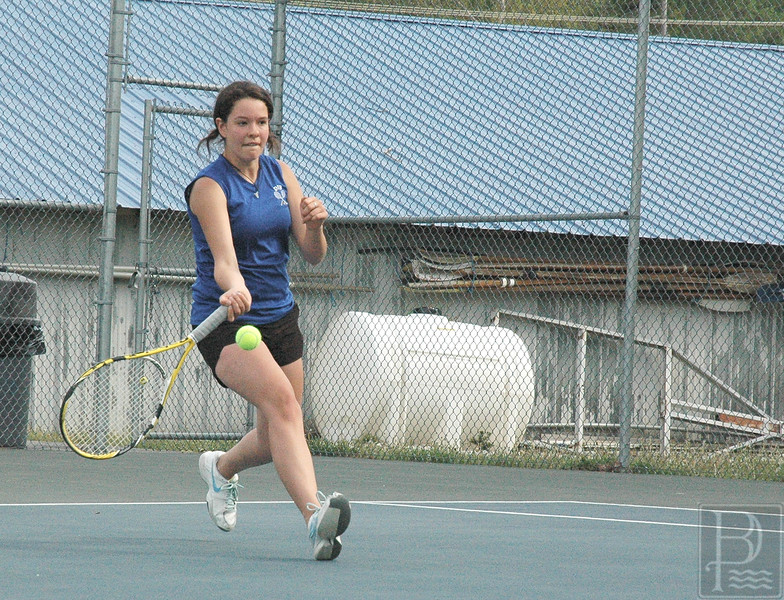 sports; DIS; tennis; sumner; justine; 052616; Deer IsleStonington High School; Mariners; dishs; game; high school; school; team Senior Justine Rhys smacks a forehand in a match against Sumner. Jack Scott
