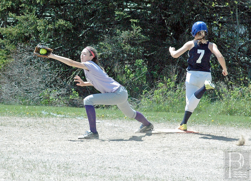 sports; DIS; softball; greenville; sadie; rice; 052616; Deer IsleStonington High School; Mariners; dishs; game; high school; school; team Freshman Sadie Rice makes the catch, with eyes closed. Photo by Jack Scott