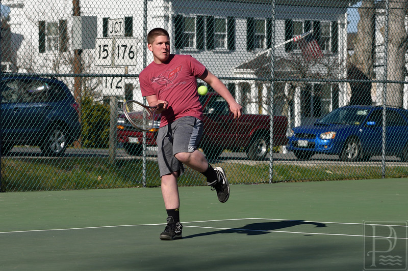 sports; GSA; dis; tennis; devon; emrick; 050516; Eagles; George Stevens Academy; game; high school; school; sport; team Devon Emeric strikes a return against George Stevens Academy. Photo by Franklin Brown