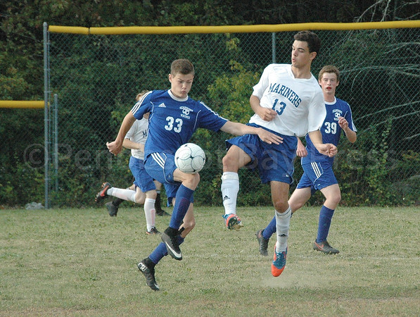 sports; DIS; searsport; arthur; valente; 092916; Deer IsleStonington High School; Mariners; dishs; game; high school; school; team Arthur Valente works for the ball against Searsport. Photo by jack Scott