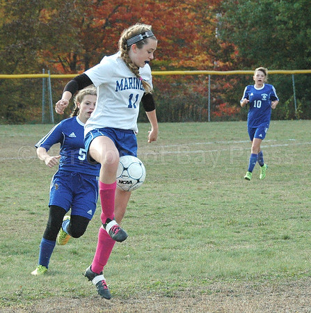 sports; DIS; girls; soccer; searsport; lilly; Gray; 102016; Deer IsleStonington High School; Mariners; dishs; game; high school; school; team Mariner Lilly Gray maintains control. against Searsport. Photo by Jack Scott
