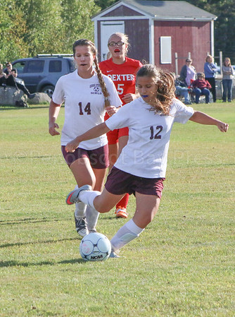 Sports; gsa; girls; dexter; duo; 092216 Tatiana Heggestad gets back up from sister Yulia as they work towards the Dexter goal. Photo by Anne Berleant