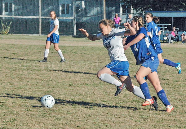 sports; DIS; girls; Searsport; Aja; 092216; Deer IsleStonington High School; Mariners; dishs; game; high school; school; team Mariner Aja Quintal races foro the ball against Searsport. Photo by Jack Scott