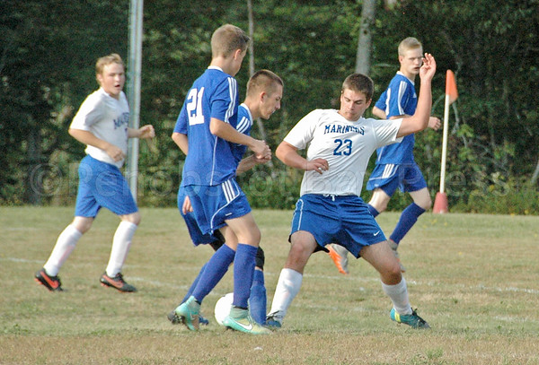 sports; DIS; searsport; nathan; winchester; 092916; Deer IsleStonington High School; Mariners; dishs; game; high school; school; team Mariner Nathan Winchester fights for the ball against Searsport. Photo by Jack Scott