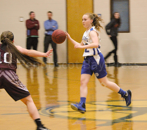 Junior Kaley Eaton works the ball down court in a preseason scrim- mage against Narraguagus on December 4. By Jack Scott