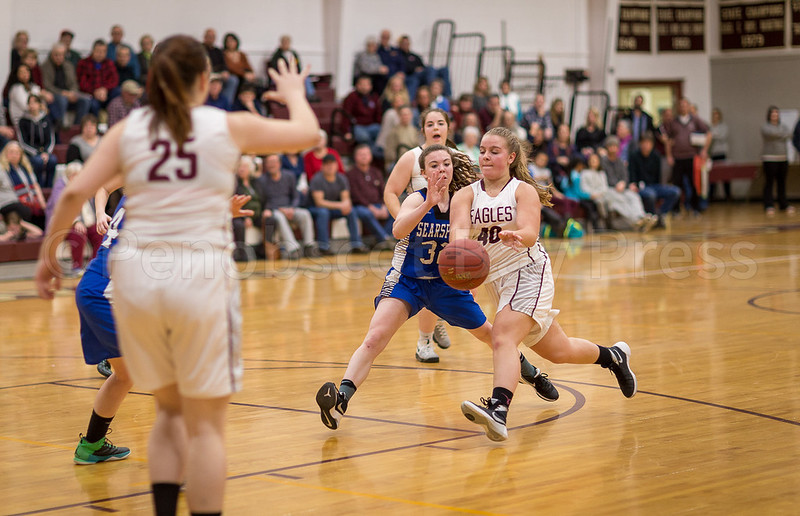sports; GSA; girls; Searsport; crosby; 021617; Eagles; George Stevens Academy; basketball; game; high school; school; sport; team Emma Crosby releases a pass to teammate Josie Clark. Photo by Tate Yoder