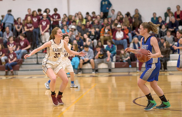 sports; GSA; girls; Searsport; smallidge; 021617; Eagles; George Stevens Academy; basketball; game; high school; school; sport; team Mazie Smallidge side steps while on defensive against Searsport. Photo by Tate Yoder
