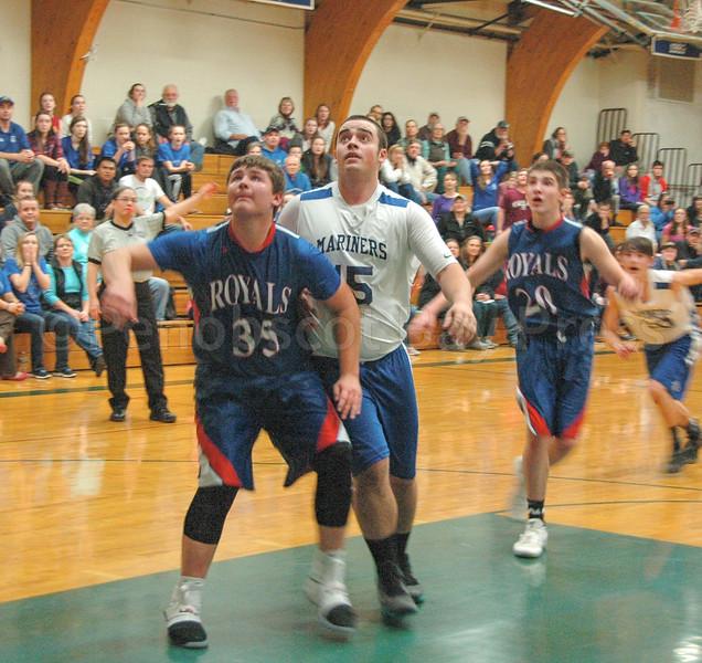 sports; DIS; boys; ethan; shepard; 020217; Deer IsleStonington High School; Mariners; dishs; game; high school; school; team Ethan Shepard looks for the rebound. Photo by Jack Scott