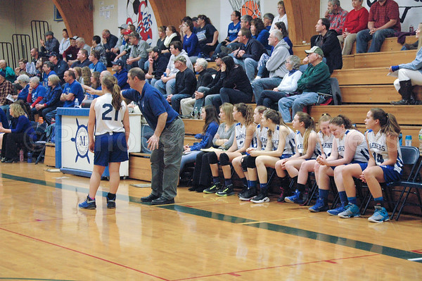 sports; DIS; girls; coach; brienna; 020217; Deer IsleStonington High School; Mariners; dishs; game; high school; school; team Coach Randy Shepard directs Brienna Limeburner during the win against Jonesport. Photo by Jack Scott