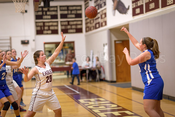 sports; GSA; DIS; girls; yulia; heggestad; 020917; Eagles; George Stevens Academy; game; high school; school; sport; team Mariner Madison Frazier passes over Yulia Heggestad in the final seconds of the game. Photo by Tate Yoder