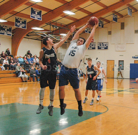 sports; DIS; Boys; EthanS; Rebound; 011217; Deer IsleStonington High School; Mariners; basketball; dishs; game; high school; team Ethan Shepard gets the rebound.  Photo by Jack Scott