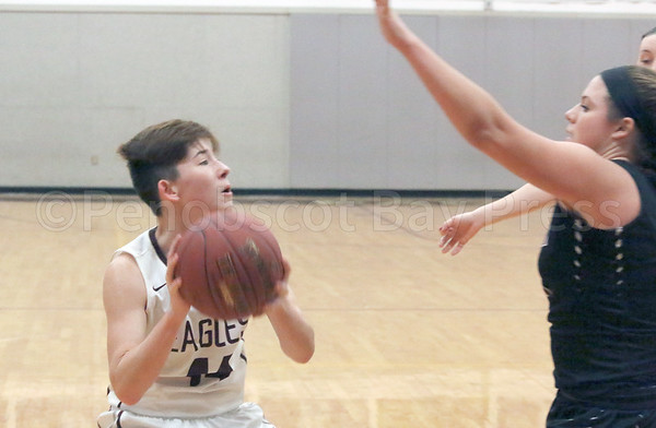 sports; GSA; girls; ellsworth; hutchinson; 011217; Eagles; George Stevens Academy; game; high school; school; sport; team Dawn Hutchinson looks for an opening astThe Ellsworth defense shuts down the Lady Eagles. Photo by Anne Berleant