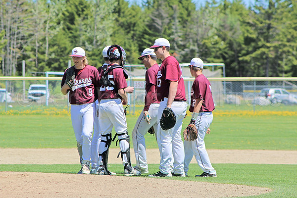 sports; GSA; baseball; Dexter; mound; 052517; Eagles; George Stevens Academy; game; high school; school; sport; team The infield confers on the mound, down against Dexter on May 20. Photo by Anne Berleant