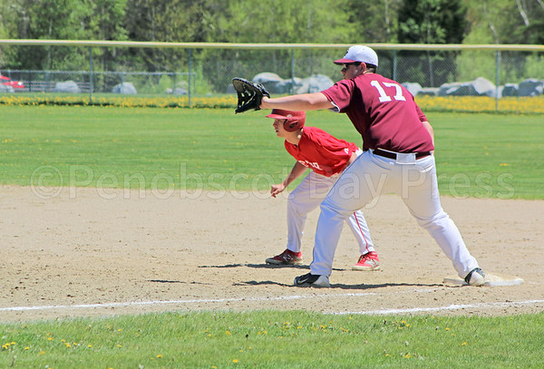sports; GSA; dexter; jackson; billings; 052517; Eagles; George Stevens Academy; game; high school; school; sport; team First baseman Jackson Billings stands ready against Dexter on May 20. Photo by Anne Berleant