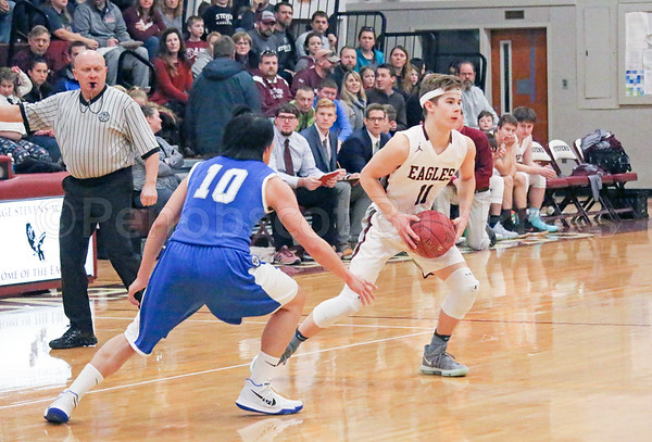 Eagles; GSA; George Stevens Academy; basketball; boys; game; high school; school; sport; sports; team Eagle Caden Mattson looks for an opening. The sophomore scored 14 points in the fourth quarter to push GSA into the lead. By Anne Berleant