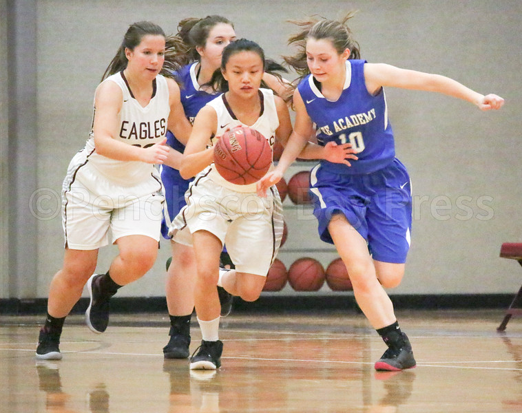 Eagles; GSA; George Stevens Academy; basketball; game; girls; high school; school; sport; sports; team Sophomore Silas Murnik steals and makes a fast break during the Eagles' win agianst Lee Academy January 6. By Anne Berleant