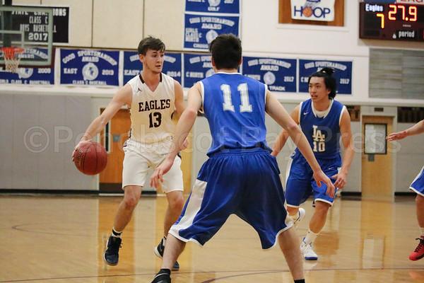 Eagles; GSA; George Stevens Academy; basketball; boys; game; high school; school; sport; sports; team Junior Isaac Wardwell moves the Eagle offense. By Anne Berleant